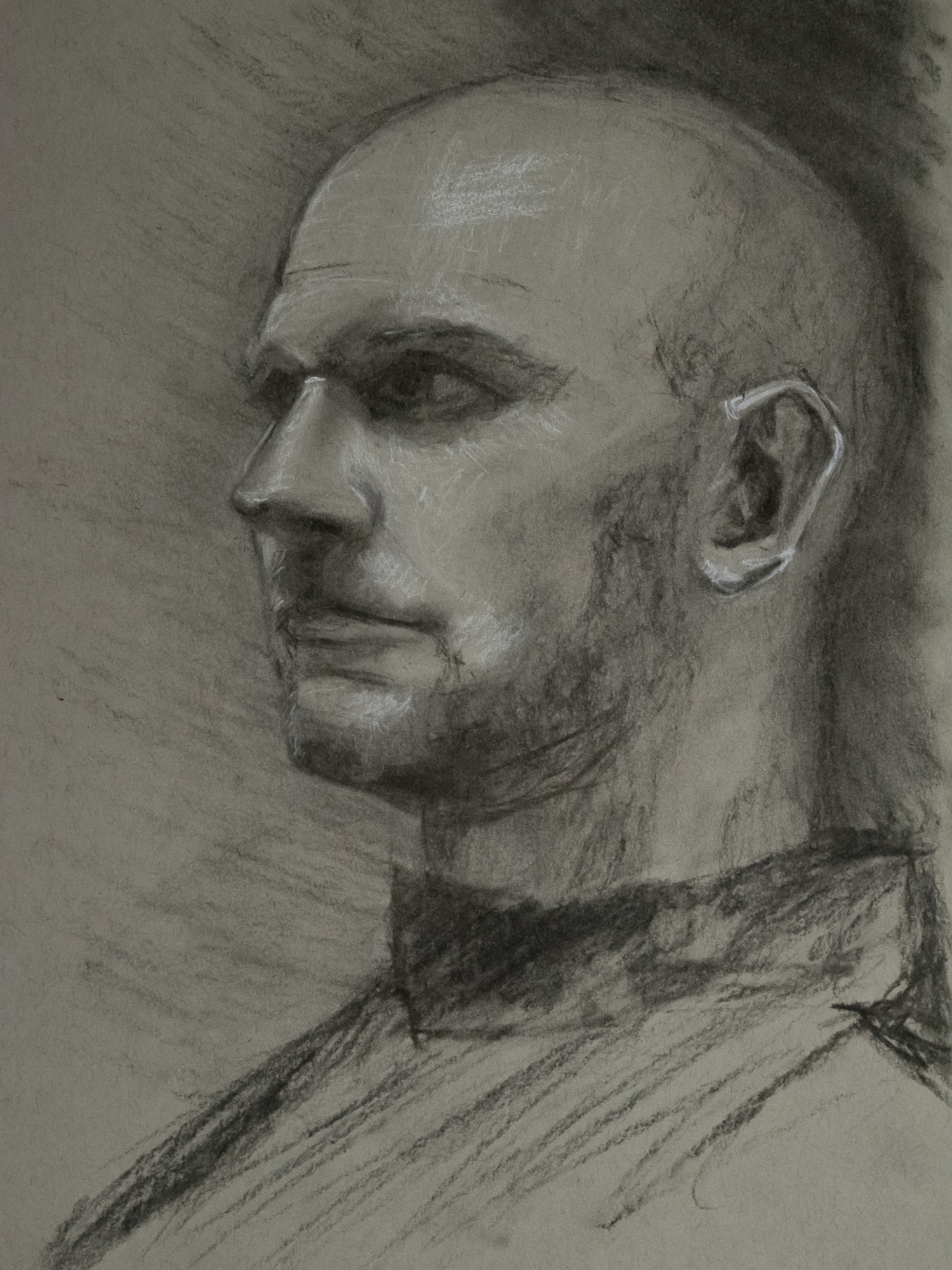Portrait of a man in charcoal on toned paper
