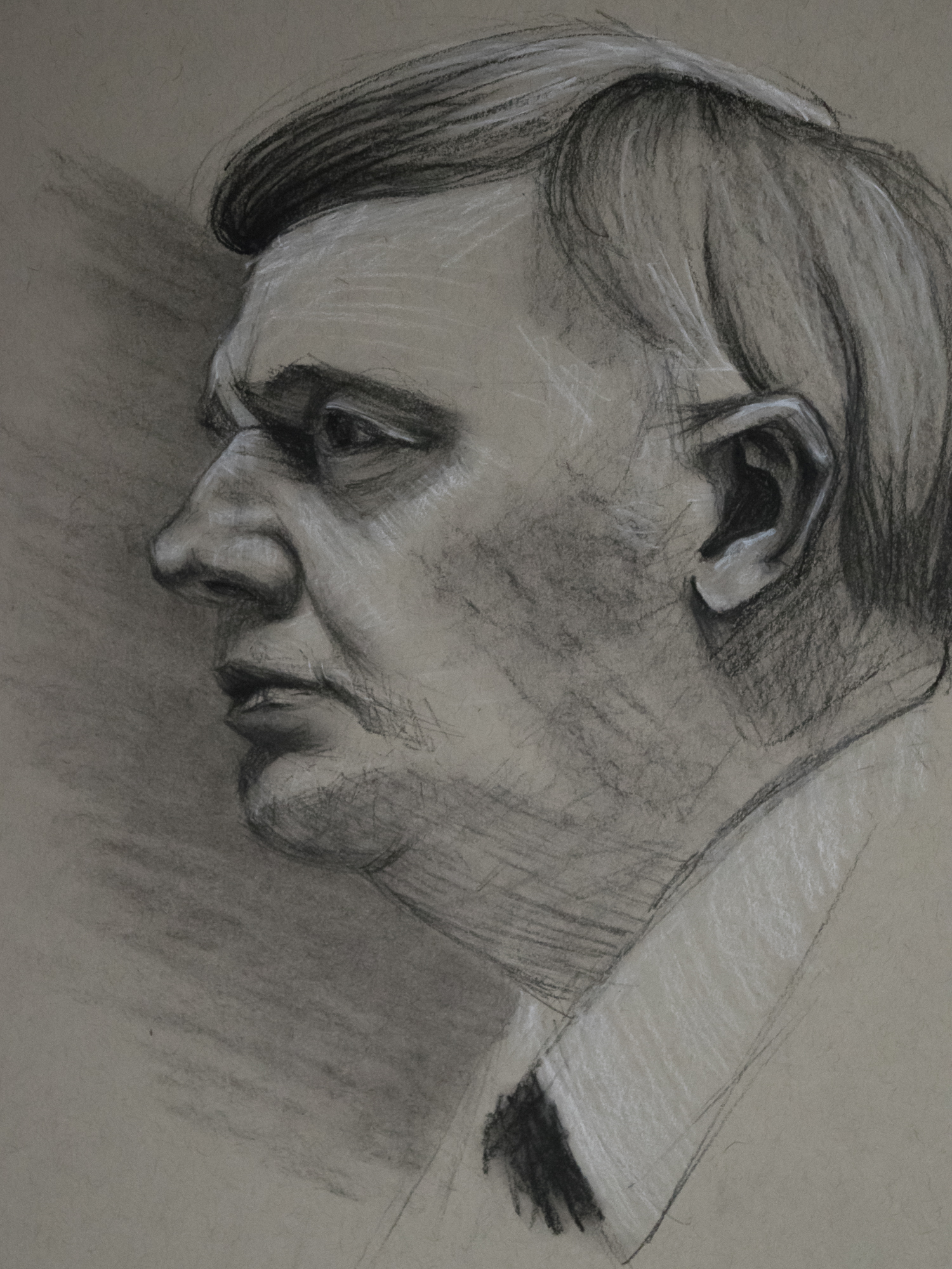 Male portrait in Charcoal on Grey Paper